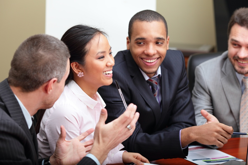 Multi ethnic business team at a meeting. Interacting. Focus on woman.jpeg