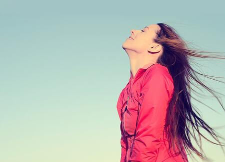 Woman smiling looking up to blue sky taking deep breath celebrating freedom. Positive human emotion face expression feeling life perception success peace mind concept. Free Happy girl enjoying nature.jpeg