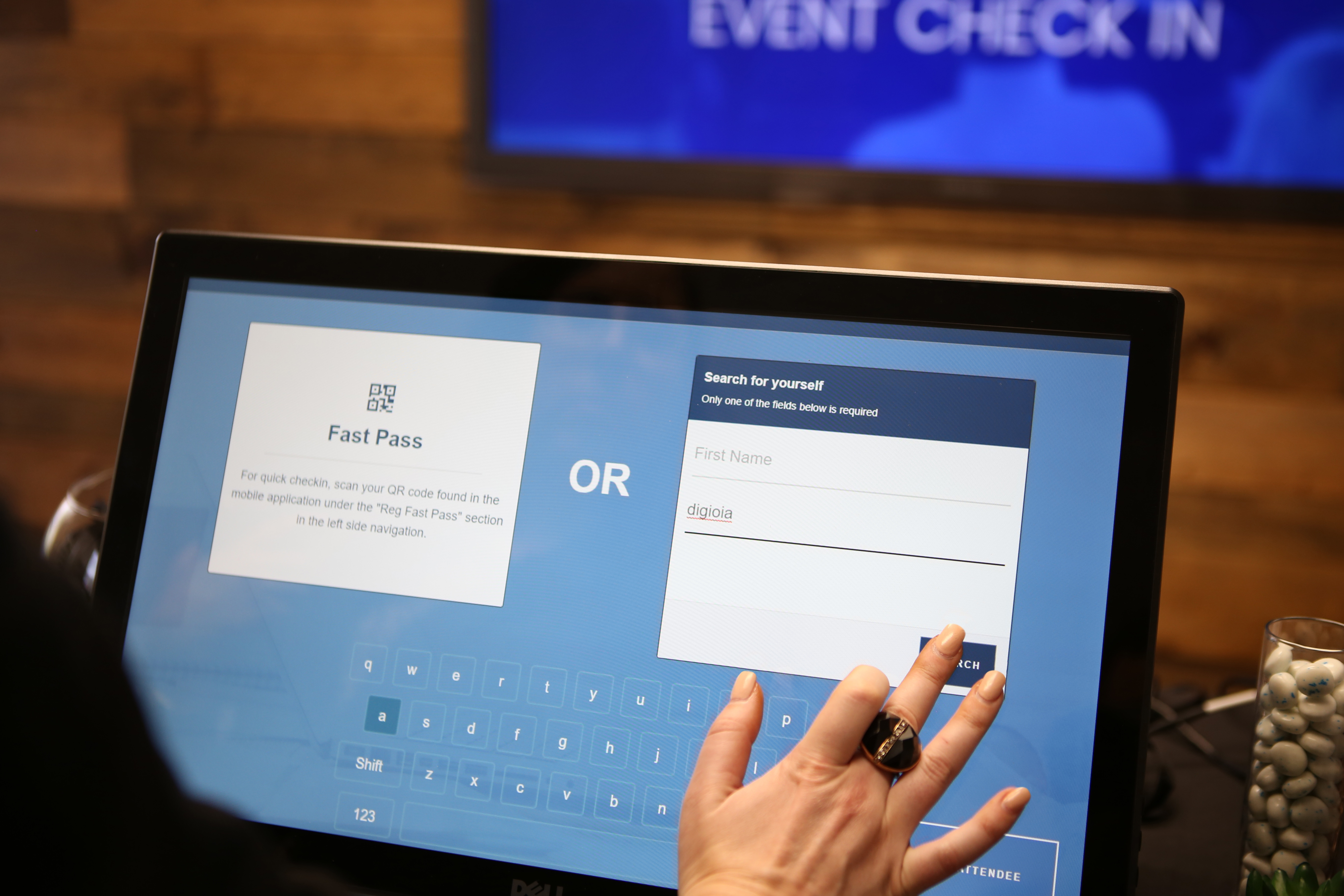 Woman checking in with an online kiosk